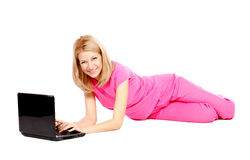 Beautiful Young Woman In Pink Lying On The Floor Stock Image