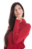 Beautiful young woman isolated with a red pullover is looking in Royalty Free Stock Photography