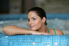 Beautiful young woman at a jacuzzi. Stock Photos