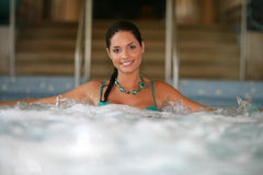 Beautiful young woman at a jacuzzi Stock Photos