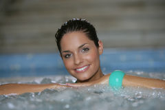 Beautiful young woman at a jacuzzi Royalty Free Stock Image