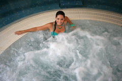 Beautiful young woman at a jacuzzi Royalty Free Stock Photography