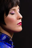 Beautiful young woman. Japanese makeup. Portrait on black Royalty Free Stock Photo