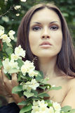 Beautiful young woman with jasmine Stock Images
