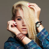 Beautiful young woman in jeans and accessories. hippies blond Sexy gir. Fashion portrait of beautiful young woman in jeans and accessories. hippies blond Sexy Stock Photo