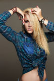 Beautiful young woman in jeans and accessories. hippies blond Sexy gir. Fashion portrait of beautiful young woman in jeans and accessories. hippies blond Sexy Royalty Free Stock Photography