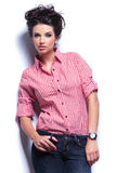 Beautiful young woman in jeans and red shirt Stock Photo