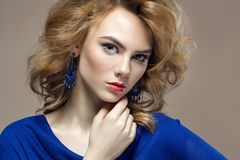 Beautiful young woman in jewelry Stock Images