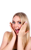 Beautiful young woman is joyfully surprised Royalty Free Stock Images