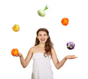 Beautiful young woman juggling Royalty Free Stock Images