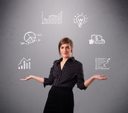 Beautiful young woman juggling with statistics and graphs Stock Photo