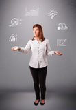 Beautiful young woman juggling with statistics and graphs Royalty Free Stock Photos