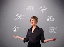 Beautiful young woman juggling with statistics and graphs Royalty Free Stock Images