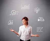 Beautiful young woman juggling with statistics and graphs Royalty Free Stock Photography