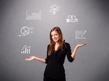Beautiful young woman juggling with statistics and graphs Royalty Free Stock Photo
