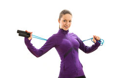 Beautiful young woman with jump rope Royalty Free Stock Photography