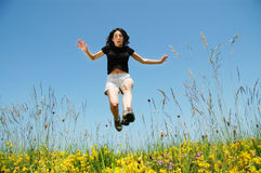 Beautiful young woman jumping Royalty Free Stock Photo