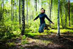 Beautiful young woman jumping Royalty Free Stock Images