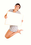 Beautiful young woman jumping with blank poster Stock Photography