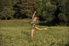 Beautiful Young Woman Jumping In Meadow Royalty Free Stock Photos