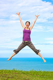 Beautiful young woman jumping and laughing Royalty Free Stock Photo