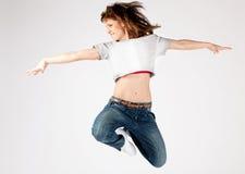 Beautiful young woman jumping Stock Photo