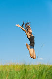 Beautiful young woman jumping up Royalty Free Stock Photo