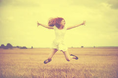 Beautiful young woman jumping at wheat field Stock Images