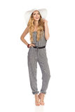 Beautiful Young Woman In Jumpsuit, Sun Hat And High Heels Is Standing And Talking Stock Photography