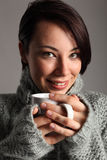 Beautiful young woman keeps warm drinking coffee Royalty Free Stock Photos