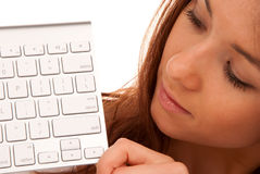 Beautiful young woman and keyboard Stock Images
