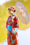 Beautiful young woman in kimono Stock Photos