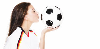 Beautiful young woman kissing a football Stock Photography