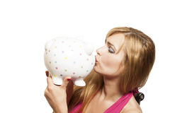 Beautiful young woman kissing piggybank Royalty Free Stock Images