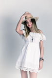 Beautiful young woman in a lace dress and a white cowboy hat Royalty Free Stock Images