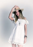 Beautiful young woman in a lace dress and a white cowboy hat Stock Photo