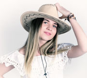 Beautiful young woman in a lace dress and a white cowboy hat Royalty Free Stock Photo