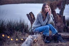 Beautiful young woman by the lake royalty free stock photo