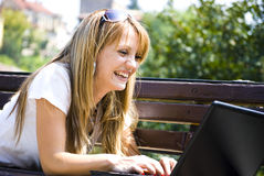 Beautiful young woman with laptop Royalty Free Stock Photos