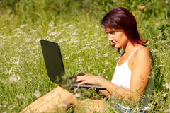 Beautiful young woman with a laptop Stock Images