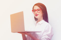 beautiful young woman with laptop standing in front of the wonderful blue background royalty free stock images