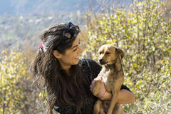 Beautiful young woman laughing and  hugging dog. Happy girl  hugging dog outdoor Royalty Free Stock Photography