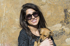 Beautiful young woman laughing and  hugging dog. Happy girl  hugging dog outdoor Royalty Free Stock Photos