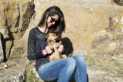 Beautiful young woman laughing and  hugging dog Royalty Free Stock Images