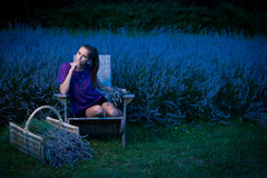 Beautiful young woman on lavander field at dusk - lavanda girl Royalty Free Stock Photos