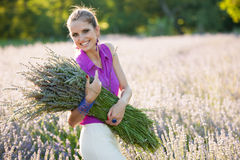 Beautiful young woman on lavander field - lavanda girl Royalty Free Stock Photography