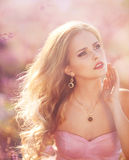 Beautiful young woman in the lavender fields. Royalty Free Stock Photos