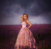 Beautiful young woman in the lavender fields. Stock Image
