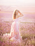 Beautiful young woman in the lavender fields. Royalty Free Stock Photo