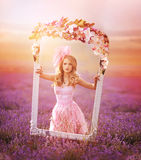 Beautiful young woman in the lavender fields. Stock Photo